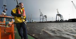 Port of Tyne Boatman Paul Ridley aboard pilot cutter Collingwood, River Tyne during filming for Sea Cities